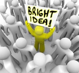 18507388-un-hombre-sostiene-un-cartel-con-la-palabra-idea-brillante-para-simbolizar-la-sugerencia-de-un-plan-